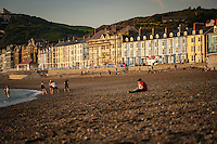 UK Weather: Aberystwyth, Ceredigion, West Wales <br />People on the beach during the early evening.