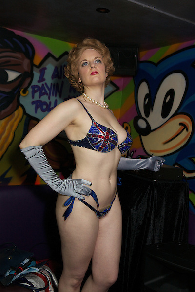 Margaret Thatcher impersonator Honey Wilde poses during a strip tease at Maggies Nightclub in Chelsea