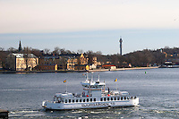 Djurgårdsbåt Djurgard boat for local traffic between Slussen and Djurgarden. Kastellholmen in the background. Stockholm. Sweden, Europe.