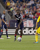 New England Revolution midfielder Shalrie Joseph (21) passes the ball. The New England Revolution tied Columbus Crew, 2-2, at Gillette Stadium on September 25, 2010.