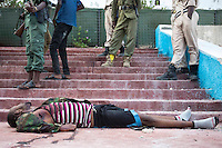 A dead al-shabaab militant lies on the steps of the Somali Parliament.