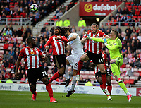 Fernando Llorente of Swansea City (C) receives the ball to score his opening goal while challenged by John O'Shea 94th L) and Jordan Pickford of Sunderland (R) during to the Premier League match between Sunderland and Swansea City at the Stadium of Light, Sunderland, England, UK. Saturday 13 May 2017