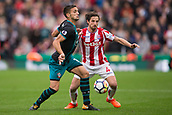 30th September, bet365 Stadium, Stoke-on-Trent, England; EPL Premier League football, Stoke City versus Southampton; Southampton's Dusan Tadic is tackled by Stoke City's Joe Allen