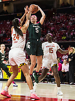 COLLEGE PARK, MD - FEBRUARY 03: Claire Hendrickson #5 of Michigan State shoots over Stephanie Jones #24 of Maryland during a game between Michigan State and Maryland at Xfinity Center on February 03, 2020 in College Park, Maryland.