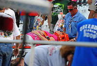 Apr 26, 2009; Talladega, AL, USA; A NASCAR Sprint Cup Series fan is carried out of the grandstands by medics after being injured from debris from a last lap crash during the Aarons 499 at Talladega Superspeedway. Mandatory Credit: Mark J. Rebilas-