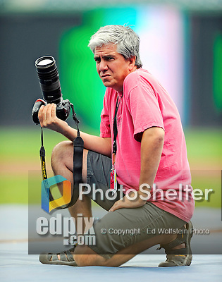 19 June 2011: Washington Nationals' team photographer Mitchell Layton at work prior to a game between the Baltimore Orioles and the Washington Nationals at Nationals Park in Washington, District of Columbia. The Orioles defeated the Nationals 7-4 in inter-league play, and ended Washington's 8-game winning streak. Mandatory Credit: Ed Wolfstein Photo