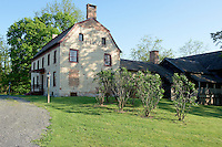 The early stone house was built in the 1600s and, as the Konyn family prospered, they added the brick house to the front and a carriage house on the back