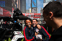 Former men's national team player Cobi Jones jokes around with Tab Ramos while being interviewed during the centennial celebration of U. S. Soccer at Times Square in New York, NY, on April 04, 2013.