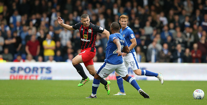 Blackburn Rovers' Paul Caddis and Oldham Athletic's Gevaro Nepomuceno<br /> <br /> Photographer Stephen White/CameraSport<br /> <br /> The EFL Sky Bet League One - Oldham Athletic v Blackburn Rovers - Saturday 14th October 2017 - Boundary Park - Oldham<br /> <br /> World Copyright &copy; 2017 CameraSport. All rights reserved. 43 Linden Ave. Countesthorpe. Leicester. England. LE8 5PG - Tel: +44 (0) 116 277 4147 - admin@camerasport.com - www.camerasport.com