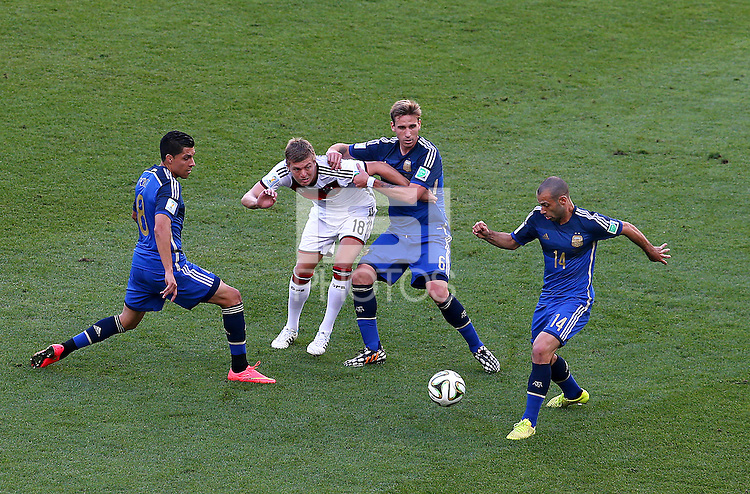 Toni Kroos of Germany is surrounded by Argentina players