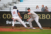 Kane County Cougars first baseman Marty Herum (14) waits for a throw as T.J. White (16) gets back to the bag during a game against the Cedar Rapids Kernels on August 18, 2015 at Perfect Game Field in Cedar Rapids, Iowa.  Kane County defeated Cedar Rapids 1-0.  (Mike Janes/Four Seam Images)
