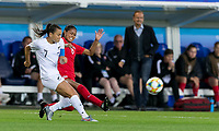 GRENOBLE, FRANCE - JUNE 15: Ali Riley #7 of the New Zealand National Team passes the ball as Jayde Riviere #8 of the Canadian National Team pressures during a game between New Zealand and Canada at Stade des Alpes on June 15, 2019 in Grenoble, France.