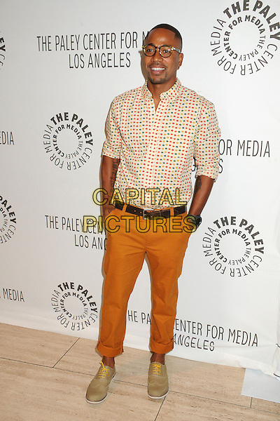 "Columbus Short.PaleyFest 2012 Fall TV Preview - ""Scandal"" held at The Paley Center, Beverly Hills, California, USA..September 11th, 2012.full length trousers hands in pockets shirt red yellow green orange maple leaf leaves print glasses goatee facial hair .CAP/ADM/BP.©Byron Purvis/AdMedia/Capital Pictures."