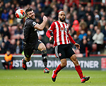 David McGoldrick of Sheffield Utd and Grant Hanley of Norwich City during the Premier League match at Bramall Lane, Sheffield. Picture date: 7th March 2020. Picture credit should read: Simon Bellis/Sportimage