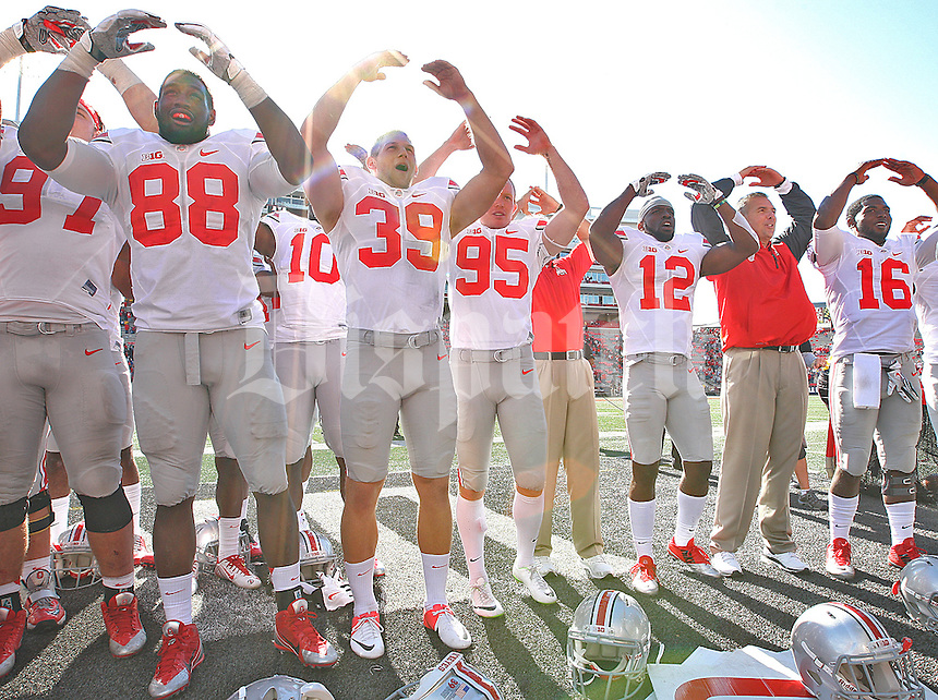 The Buckeyes and head coach Urban Meyer celebrate after their win against Maryland at Byrd Stadium on October 4, 2014.  (Chris Russell/Dispatch Photo)