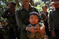 Relatives of veterans of the CIA Secret War break down in tears at their hidden village in the Vientiane province of Laos on 27 November 2007. Thousands of Hmongs who fought or collaborated with the American CIA until communists took over the country in 1975 remain hidden in the jungles of Laos and remain regular targets of the Lao People's Army