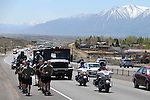 Members of the Carson City Sheriff's Office through Indian Hills, Nev., on Wednesday, May 1, 2013 as part of the 14th annual memorial run between Las Vegas and Carson City. Law enforcement agencies from across the state have participated in the 450-mile run to bring a baton containing the names of 123 Nevada peace officers who were killed in the line of duty to the site of tomorrow's annual Nevada Peace Officers Memorial. <br />