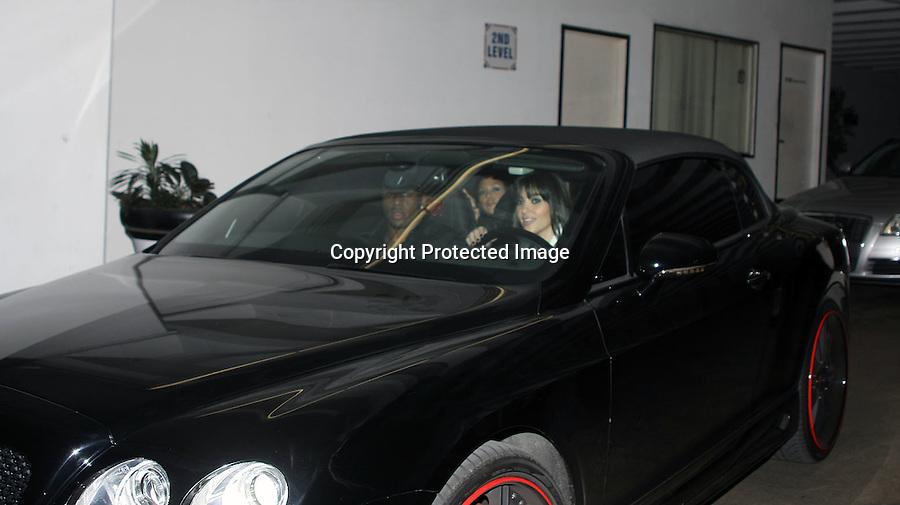 1-10-09.Kim & Kourtney Kardashian leaving a club called My House with Reggie Bush in hollywood California ..www.AbilityFilms.com.805-427-3519.AbilityFilms@yahoo.com