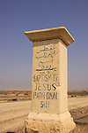 Jordan Valley, a milestone on the road to Abdullah bridge poimting to Qasr al Yahud.