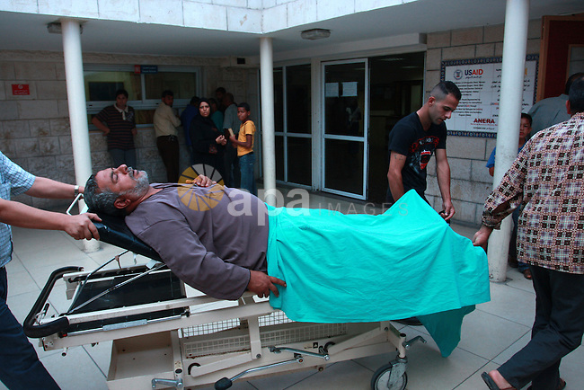 Mahmoud Abu Reiade, a Palestinian who was wounded in a confrontation with Israeli settlers in the village of Qusra, is brought to a hospital in the West Bank city of Nablus, Friday, Sept. 16, 2011. Israeli settlers assaulted the village Friday morning, leading to clashes with Israeli forces injuring 11 Palestinians. After the settlers were removed by Israeli police, Israeli forces raided Qusra village injuring another six villagers with rubber bullets, Palestinian sources said. Photo by Wagdi Eshtayah