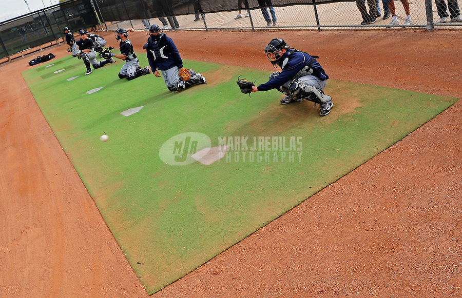 Feb. 15, 2012; Peoria, AZ, USA; Seattle Mariners catchers work during a throwing session during a pitchers and catchers workout at the Peoria Sports Complex.  Mandatory Credit: Mark J. Rebilas-.