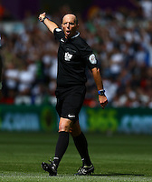 After some confusion, referee Mike Dean awards the opening goal scored by Kelechi Iheanacho of Manchester City during the Barclays Premier League match between Swansea City and Manchester City played at The Liberty Stadium, Swansea on 15th May 2016