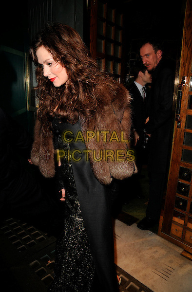 ANNA FRIEL & DAVID THEWLIS.At The Ivy Restaurant, London, England,.February 2nd 2008..full length brown fur coat jacket black and gold dress red lipstick.CAP/CAN.?Can Nguyen/Capital Pictures