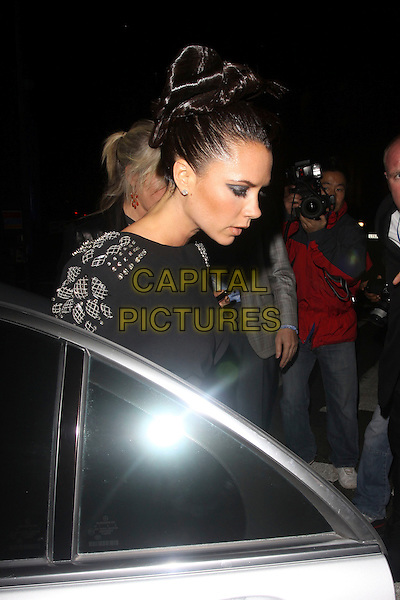 VICTORIA BECKHAM.The British Fashion Awards at Royal Courts of Justice, Strand, London, England..December 9th, 2009.half length black hair up dress blue sapphire ring jewelled embellished profile side posh spice car.CAP/AH.©Adam Houghton/Capital Pictures.
