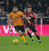 Wolverhampton Wanderers' Ruben Neves (left)  under pressure from Bournemouth's Lewis Cook (right) <br /> <br /> Photographer David Horton/CameraSport<br /> <br /> The Premier League - Bournemouth v Wolverhampton Wanderers - Saturday 23rd November 2019 - Vitality Stadium - Bournemouth<br /> <br /> World Copyright © 2019 CameraSport. All rights reserved. 43 Linden Ave. Countesthorpe. Leicester. England. LE8 5PG - Tel: +44 (0) 116 277 4147 - admin@camerasport.com - www.camerasport.com