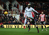 2nd December 2017, Griffen Park, Brentford, London; EFL Championship football, Brentford versus Fulham; Sheyi Ojo of Fulham attempting to score from a header which was saved by Goalkeeper Daniel Bentley of Brentford