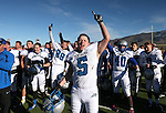 Pahranagat Valley's David Ingram celebrates with teammates after defeating Whittell 54-28 in the NIAA DIV championship game at Dayton High School in Dayton, Nev., on Saturday, Nov. 21, 2015. (Cathleen Allison/Las Vegas Review Journal)