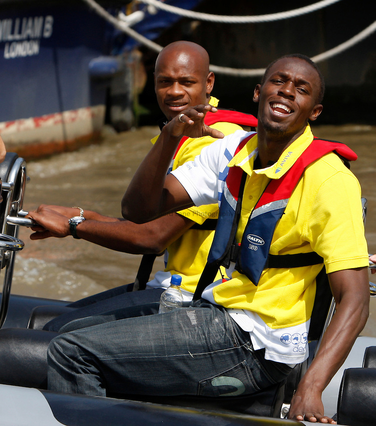 Photo: Richard Lane/Richard Lane Photography. Photocall on the River Thames, London ahead of The Aviva London Grand Prix. 24/07/2008. Jamaician sprinters, Asafa Powell, Commonwealth 100m champion and second fastest of all time over 100m and Usain Bolt, World 100m champion and third fastest of all time over 100m enjoy a trip along the River Thames.