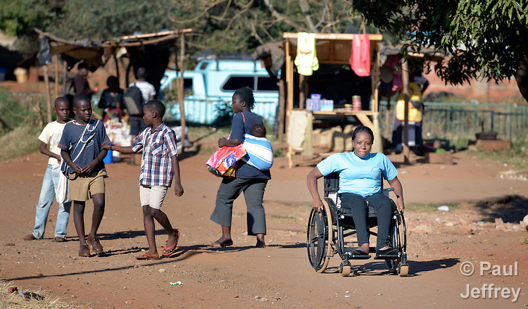 Tatenda Mafuta was born with spina bifida and today uses a wheelchair in Harare, Zimbabwe. An activist for the rights of people living with disabilities, here she propels herself along a street near her home. Her wheelchair was provided by the Jairos Jiri Association with support from CBM-US.