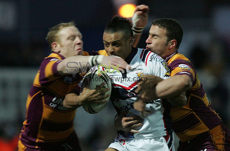 Pix by JOHN CLIFTON/SWpix.com -  Rugby League Super League, Wakefield Trinity Wildcats v Huddersfield Giants, Belle Vue, Wakefield, 04/03/06..Picture Copyright >> Simon Wilkinson >> 07811267706..Wakefield's Paul White is tackled just short of the line by Huddersfield's Mat Gardner and Paul Reilly