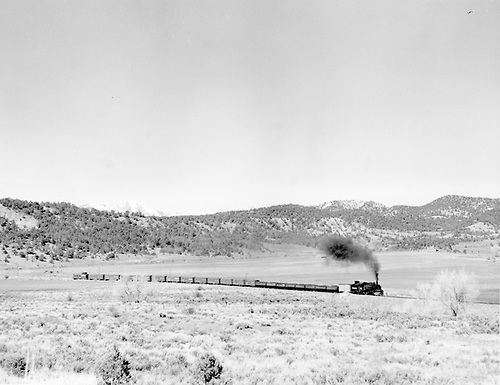 Freight train of 21 cars and caboose.<br /> D&amp;RGW  near Boca, CO  Taken by Richardson, Robert W. - 2/25/1954