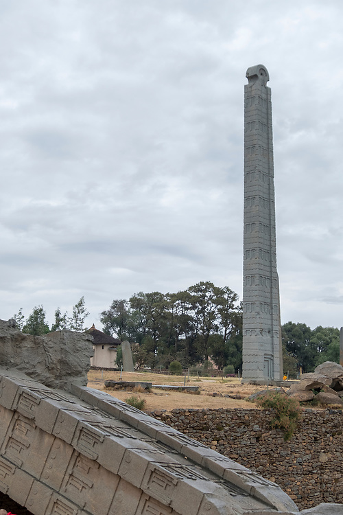 The stelae field at Axum is dominated by the stele accredited to King Ezana.  This engraved block of solid granite stands 23 meters high and is carved with a door and nine windows.  The largest stele, at 500 tons, lays shattered on the ground.