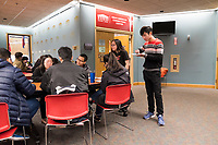 People gather in the cafeteria near Middlesex Community College's Asian American Connections Center on Thurs., Feb. 15, 2018. The Asian American Connections Center was established at the school using a federal grant in 2016 and serves as a focal point for the Asian community at the school, predominantly Cambodian, to gather, socialize, study, and otherwise take part in student life.