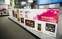 Boxes of Toshiba brand flat-screen televisions in a Best Buy store in New York on Tuesday, April 11, 2017. Toshiba announced that losses associated with its nuclear power subsidiary, Westinghouse Electric, may be so great as to prevent the company from continuing. (© Richard B. Levine)