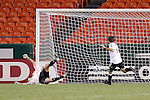 Oct 05 2007:  Christian Gomez (out of frame) puts the ball past Kevin Hartman goalie for the Wizards to tie the game.  The MLS Kansas City Wizards tied the visiting D.C.United 1-1 at Arrowhead Stadium in Kansas City, Missouri, in a regular season league soccer match.