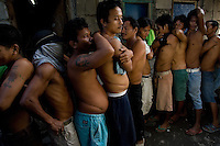 Men from the Basico port area slum of Manila show their scars from operations where they have donated thir kidneys. All recieved between 70,000 -  90,000 pesos (800 - 1030 pounds).  More than 300 have sold their kidneys in this slum of 16,000 people.<br /> <br /> PHORO BY RICHARD JONES
