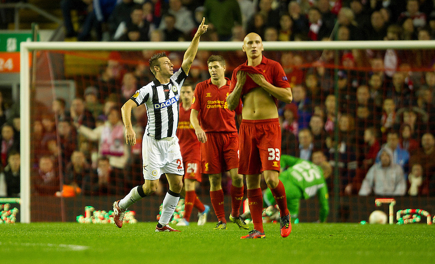 Udinese's Giovanni Pasquale celebrates scoring his sides third goal as Liverpool's Steven Gerrard  and Jonjo Shelvey looks on dejected..Football - UEFA Europa League Group A - Liverpool v Udinese - Thursday 4th October 2012 - Anfield - Liverpool. - .
