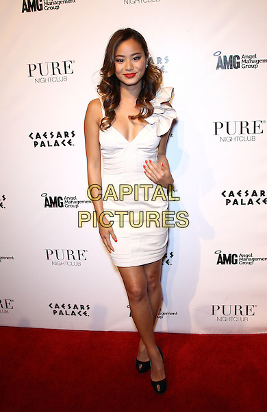 Jamie Chung .Jamie Chung hosts a night at Pure Nighclub inside Caesar's Palace Las Vegas,  Las Vegas, Nevada, USA..July 16th, 2011.full length white dress ruffle black peep toe shoes hand on hip.CAP/ADM/MJT.© MJT/AdMedia/Capital Pictures.