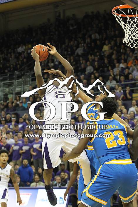 JAN 1, 2016:  Washington's #15 Noah Dickerson gets fouled as he drives to the basket against UCLA.  Washington defeated #25 ranked UCLA 96-93 in double overtime at Alaska Airlines Arena in Seattle, WA.