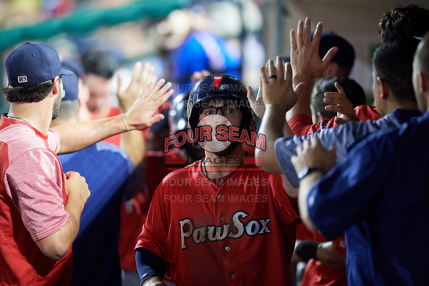 Pawtucket Red Sox right fielder Cole Sturgeon (22) high fives with his teammates in the dugout during a game against the Rochester Red Wings on July 4, 2018 at Frontier Field in Rochester, New York.  Pawtucket defeated Rochester 6-5.  (Mike Janes/Four Seam Images)