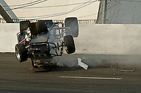 28 June, 2008, Tracy, California, USA.Midget #11 slides along the third turn after launching off another car during the main race..©2008 F.Peirce Williams, USA.F. Peirce Williams.photography.