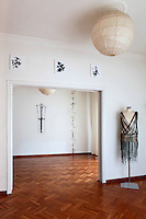 studio with art pieces..Thanos Kiriakidis lives in a 75 square meter penthouse on the 6th floor of an apartment building situated in downtown Athens, Greece. In his living room which also works as his studio, he is presenting his art project Blind Adam.