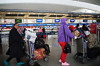 NEW YORK, NEW YORK - MARCH 03 : People walk pass the Delta Kiosks inside the John F. Kennedy International Airport as Delta and American Airlines suspend flights to Milan amid coronavirus outbreak in New York on March 03, 2020. New York confirms second coronavirus case, as flights cancelations and Jewish schools close over virus fears.The first person to test positive for coronavirus in the state is a 39-year-old health-care worker who arrived from Iran with her husband, the second one is an attorney who lives in Westchester County, works in Manhattan, Gov. Andrew Cuomo said. (Photo by Eduardo Munoz / VIEWpress via Getty Images)