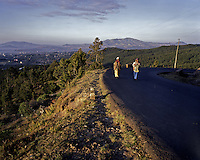 Two women walk towards the Ntoto hill to collect wood that they will sell at a local market in Ethiopia's capital Addis Ababa on Monday November 2, 2009.
