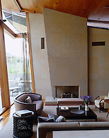 The angles of the limestone fireplace in the living room accentuate the slant of the mahogany clad ceiling