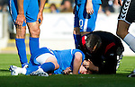 St Johnstone v St Mirren...11.09.10  .Andy Jackson is treated by physio Nick Summersgill after he collided with Paul Gallacher.Picture by Graeme Hart..Copyright Perthshire Picture Agency.Tel: 01738 623350  Mobile: 07990 594431